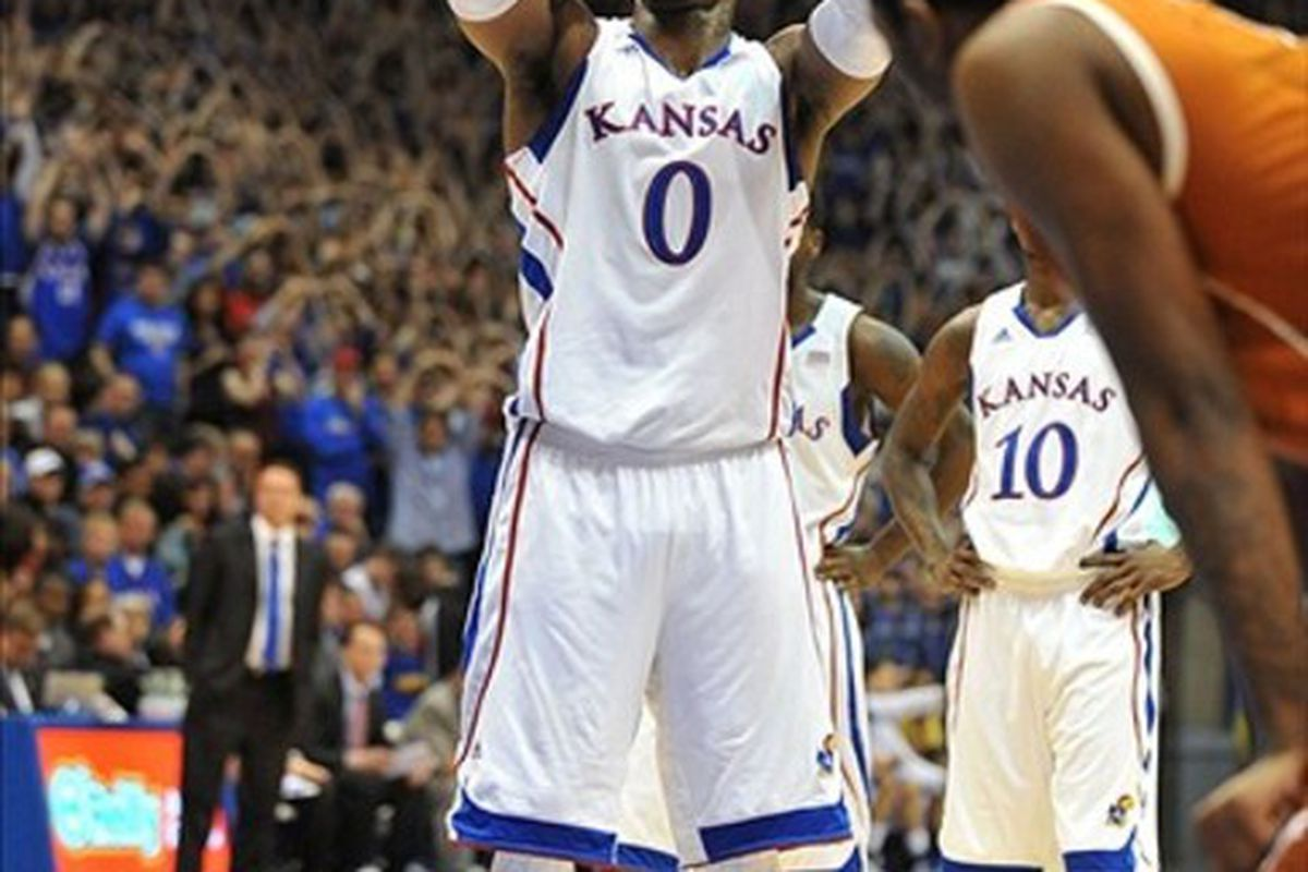 March 03, 2012; Lawrence, KS, USA; Kansas Jayhawks forward Thomas Robinson (0) shoots a free throw in the first half of the game against the Texas Longhorns at Allen Fieldhouse. Kansas won the game 73-63. Mandatory Credit: Denny Medley-US PRESSWIRE