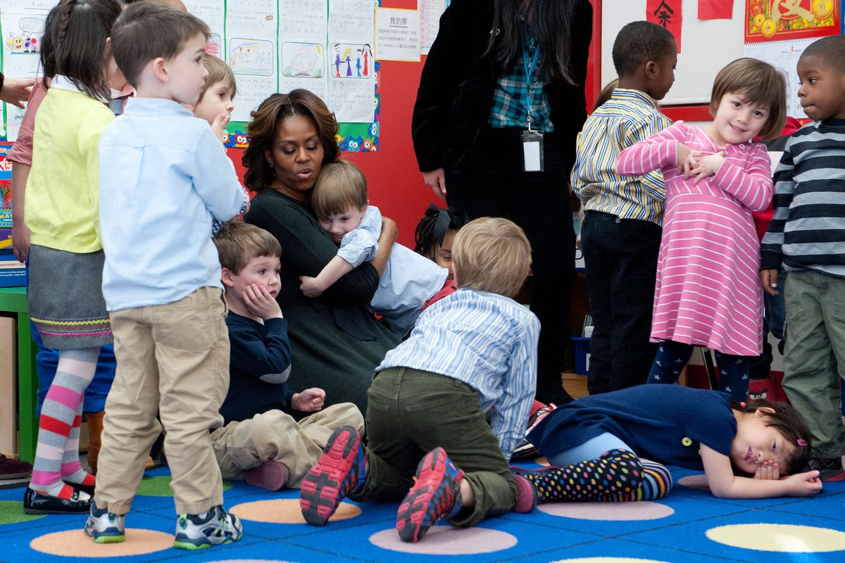 Michelle Obama hangs out with preschoolers...4 out of 10 of whom may have been in poverty during the downturn, by the numbers