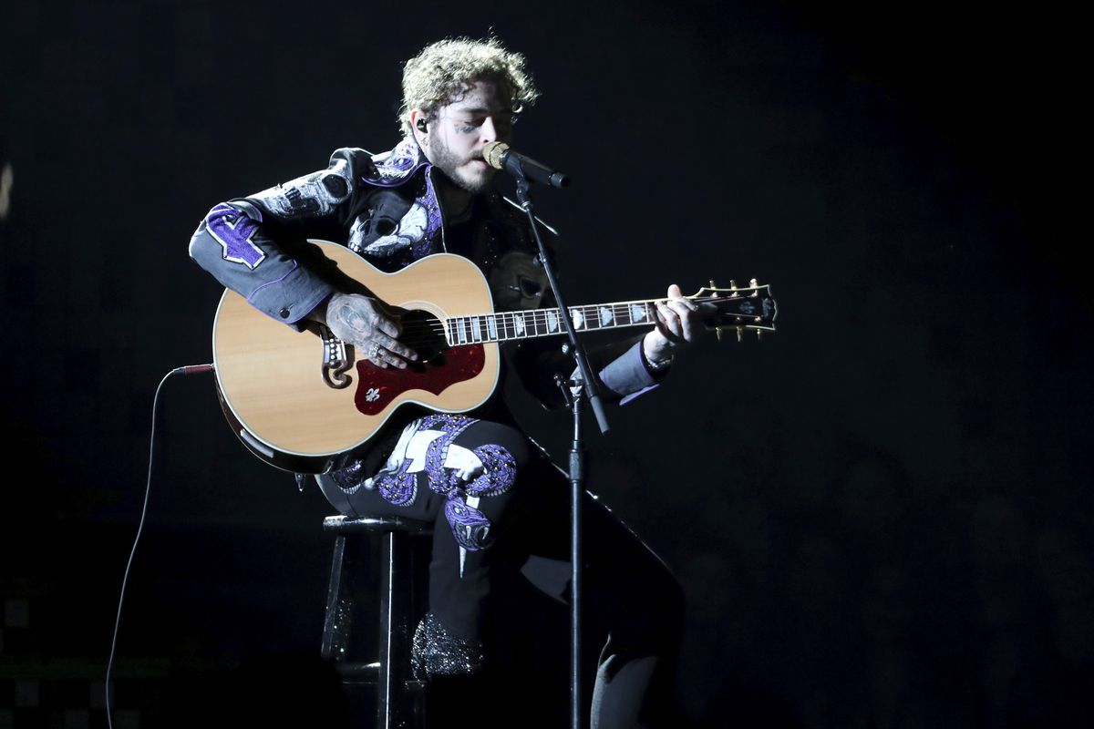 Post Malone performs a medley at the 61st annual Grammy Awards on Sunday, Feb. 10, 2019, in Los Angeles.
