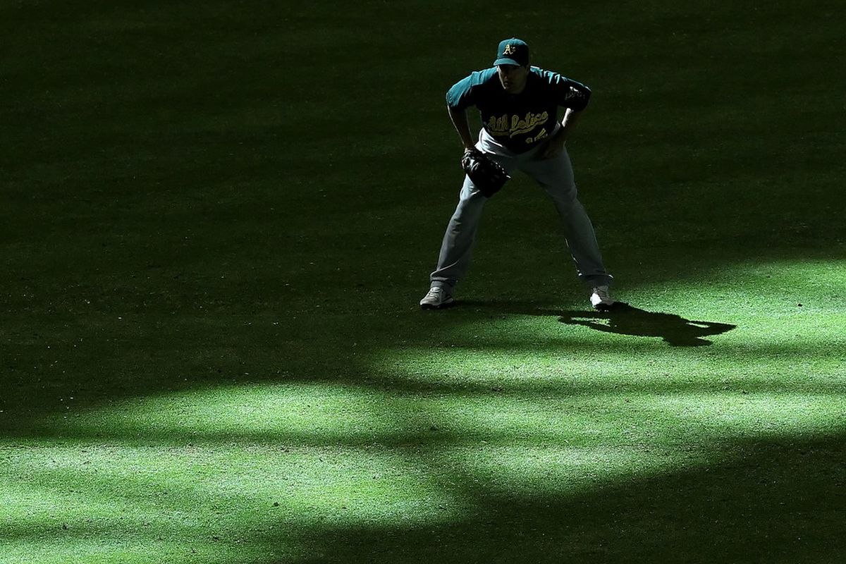PHOENIX, AZ - JUNE 10:  Outfielder Seth Smith #15 of the Oakland Athletics stands ready during the interleague MLB game against the Arizona Diamondbacks at Chase Field on June 10, 2012 in Phoenix, Arizona.  (Photo by Christian Petersen/Getty Images)