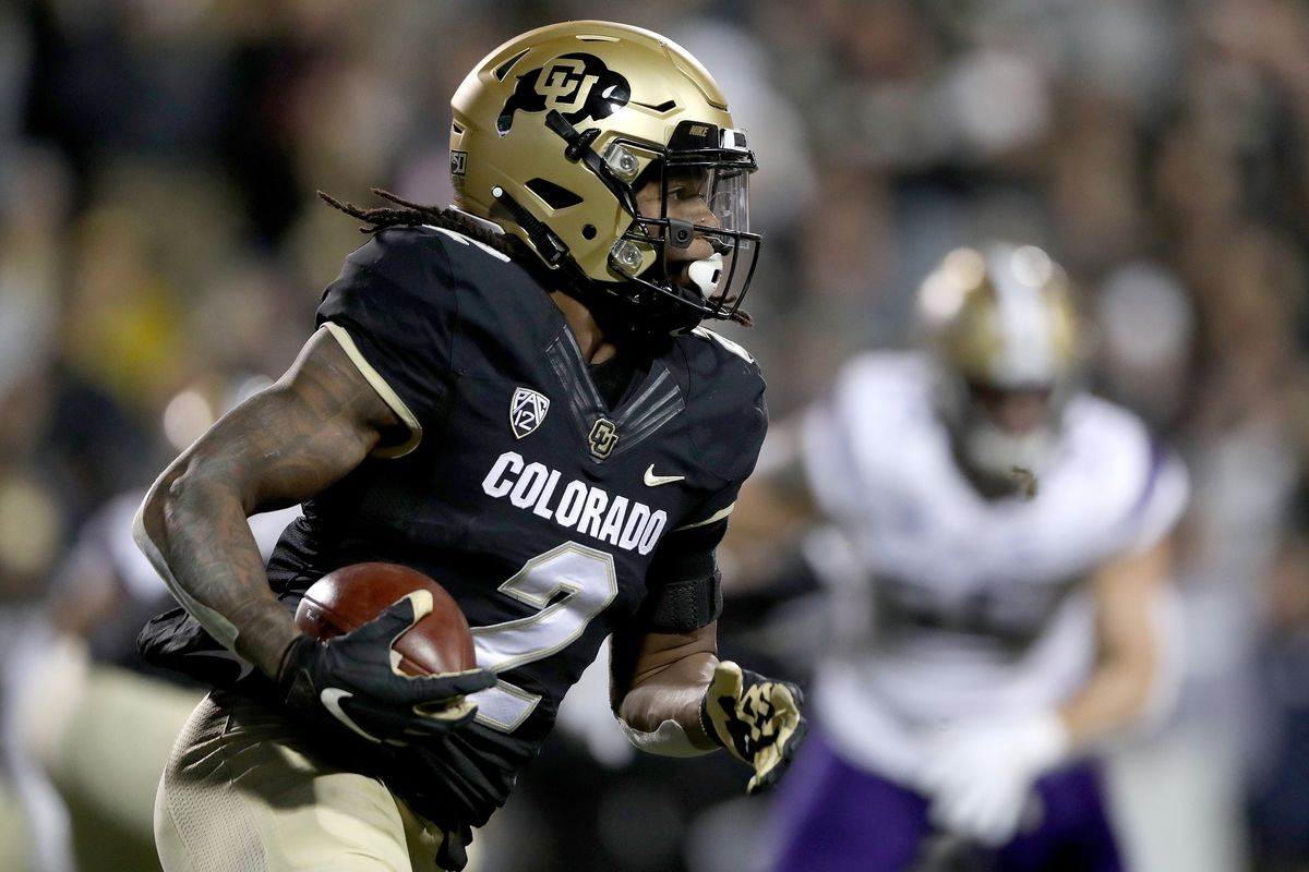 Laviska Shenault Jr. of the Colorado Buffaloes carries the ball against the Washington Huskies in the first quarter at Folsom Field on November 23, 2019 in Boulder, Colorado.