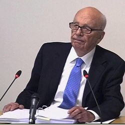 In this image from video, News Corp. chairman Rupert Murdoch appears at Lord Justice Brian Leveson's inquiry in London, Wednesday April 25, 2012 to answer questions under oath about how much he knew about phone hacking at the News of the World tabloid. Murdoch is being grilled on his relationship with British politicians at the country's media ethics inquiry, while a government minister is battling accusations he gave News Corp. privileged access in its bid to take over a major broadcaster.