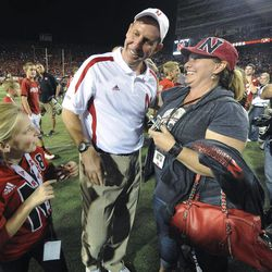 Nebraska coach Bo Pelini celebrates with his wife, Mary Pat, right, and daughter Caralyn Pelini, left, after Nebraska's 30-27 win over Wisconsin in an NCAA college football game Saturday, Sept. 29, 2012, in Lincoln, Neb.