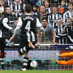 Newcastle United's Papiss Cisse, left, scores his goal past  Bolton Wanderers' goalkeeper Adam Bogdan, right, during their English Premier League soccer match at the Sports Direct Arena, Newcastle, England, Monday, April 9, 2012.
