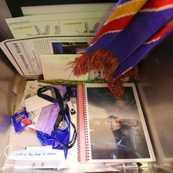 Some contents of a time capsule, including a face mask, are pictured during a ceremony to mark the 100-year anniversary of the Salt Lake City International Airport in Salt Lake City on Monday, Dec. 21, 2020.
