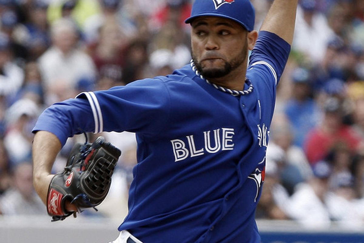 TORONTO, CANADA - JUNE 17: Luis Perez #47 of the Toronto Blue Jays throws a pitch against the Philadelphia Phillies during interleague MLB action at The Rogers Centre June 17, 2012 in Toronto, Ontario, Canada.  (Photo by Abelimages/Getty Images)