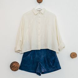 """¾ Sleeve Cropped Button Down, $88; High-Waisted Shorts, <a href=""""http://7115newyork.com/collections/apparel/products/high-waisted-shorts-ii"""">$78</a>"""