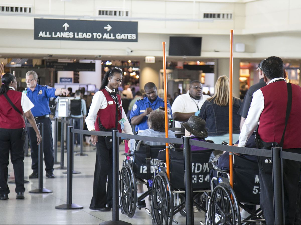 Passengers wait in security lines at Midway Airport on Thursday. | Ashlee Rezin/Sun-Times
