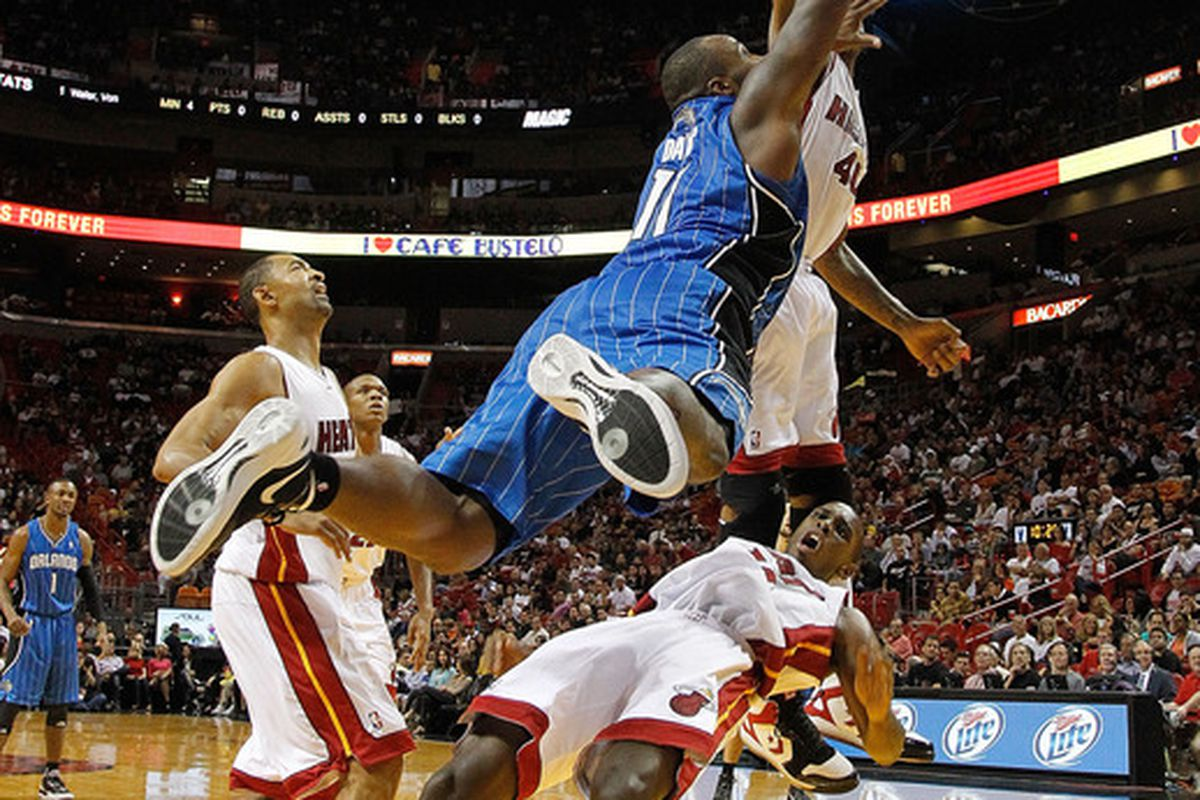 MIAMI, FL - DECEMBER 18: Glen Davis of the Orlando Magic commits a charge against Mario Chalmers of the Miami Heat during a preseason game  at AmericanAirlines Arena (Photo by Mike Ehrmann/Getty Images)