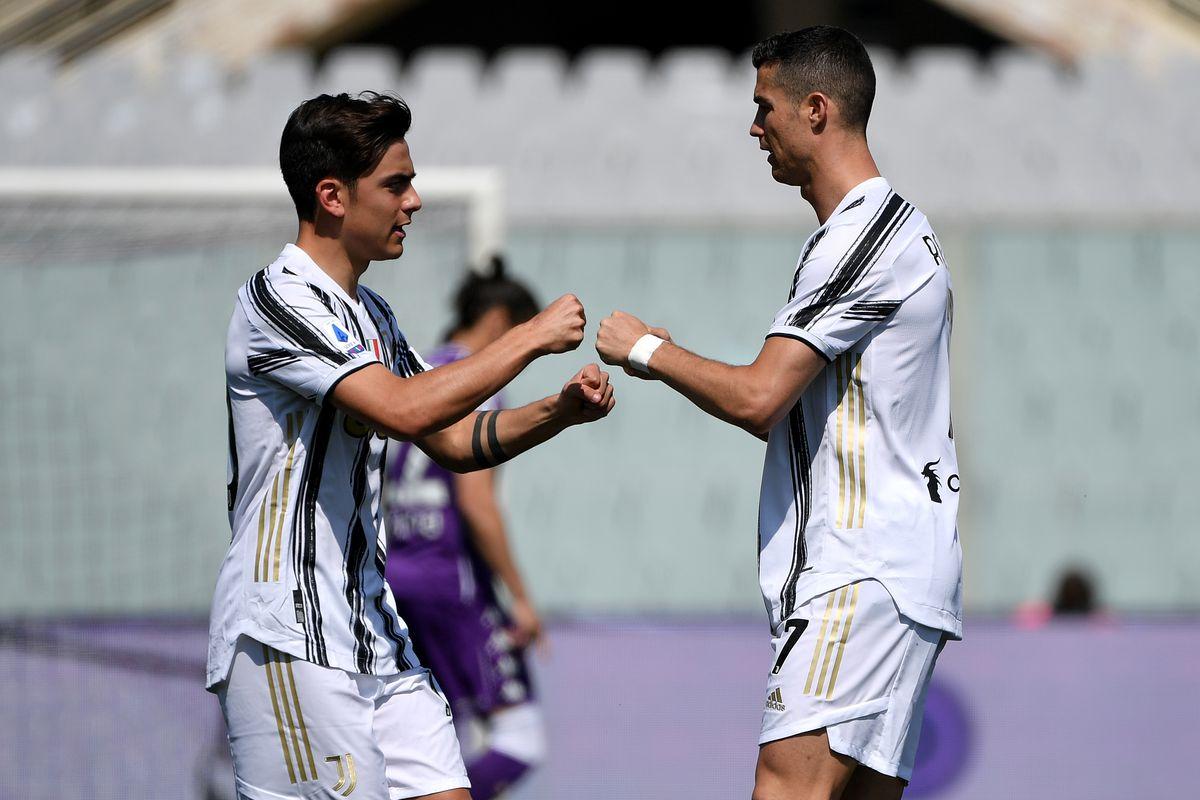 Paulo Dybala and Cristiano Ronaldo of Juventus FC encourage...