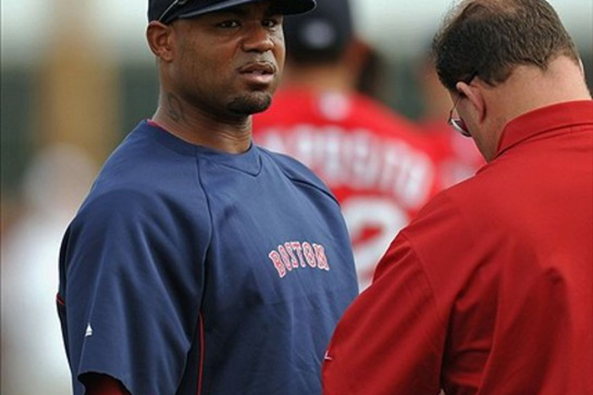 Feb 25, 2012; Fort Myers, FL, USA; Boston Red Sox left fielder Carl Crawford (13) seeks the medical assistant during spring training at JetBlue Park. Mandatory Credit: Steve Mitchell-US PRESSWIRE