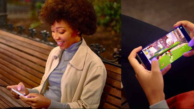 a happy woman plays an Xbox Console video game on a park bench, using touch controls