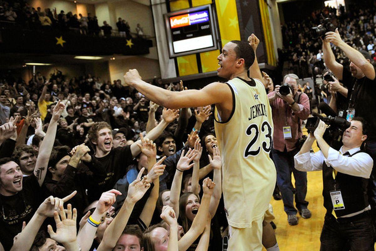 John Jenkins #23 of the Vanderbilt Commodores celebrates with fans after a win over the Kentucky Wildcats.