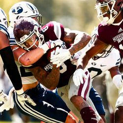 Mississippi State wide receiver Donald Gray fights for yards against BYU during the third quarter at Davis Wade Stadium in Starkville, Miss., on Saturday, Oct. 14, 2017.