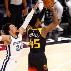 Utah Jazz guard Donovan Mitchell (45) shoots a 3-pointer with Memphis Grizzlies forward Dillon Brooks (24) defending duringGame 5 of an NBA basketball first-round playoff series at Vivint Arena in Salt Lake City on Wednesday, June 2, 2021.