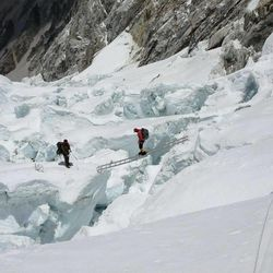 David Roskelley crosses a treacherous crevasse on his way to the summit of Mount Everest last month.