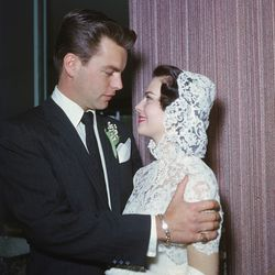 In a conservative lace look by costume designer Howard Shoup, Old Hollywood royalty Natalie Wood married Robert Wagner on December 28th, 1957.