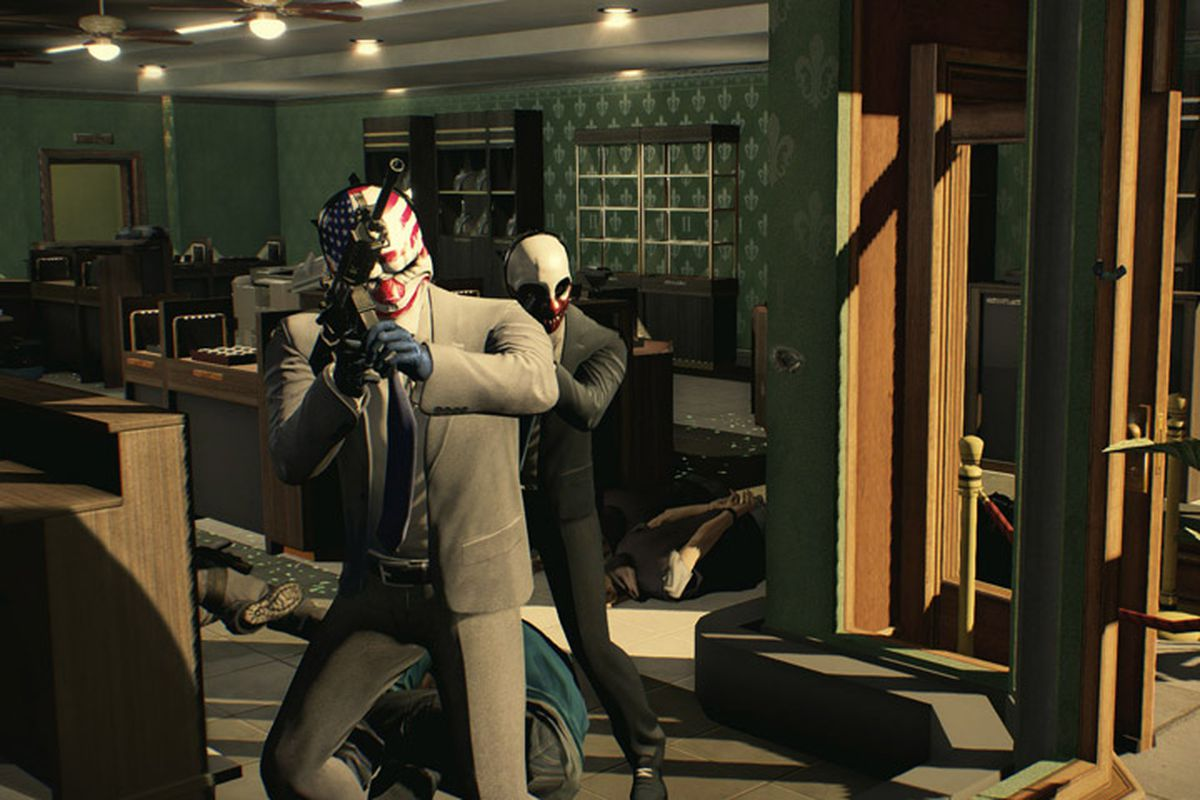 Two masked robbers hold guns inside a ransacked jewelry store in Payday 2