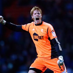 Adam Bogdan of Bolton celebrates the goal scored by team mate Kevin Davies (not pictured) during the npower Championship match between Blackburn Rovers and Bolton Wanderers at Ewood Park on November 28, 2012 in Blackburn, England. (Photo by Paul Thomas/Ge