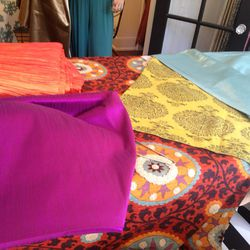 """""""It will be an outdoor house party with a Moroccan theme. Bright colors, floor pillows, hookahs, etc! [These are the] fabrics for the tables and pillows."""" - Elshane"""