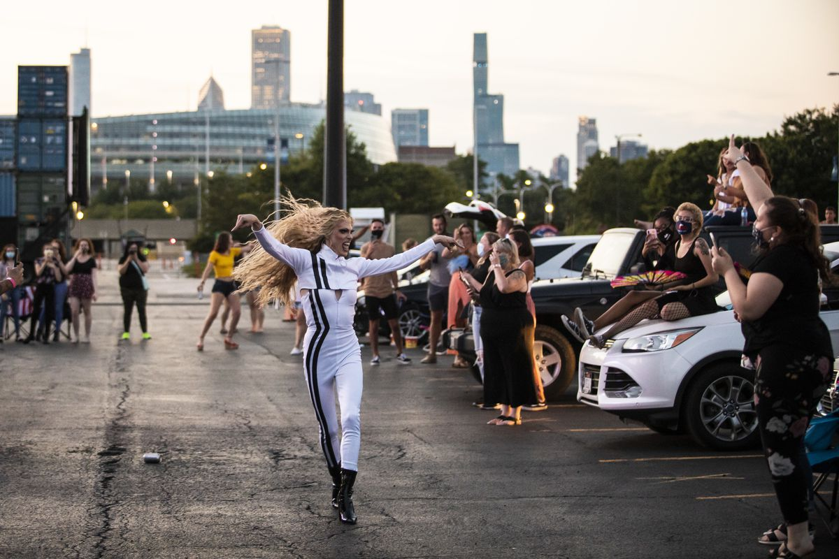 Gigi Goode runs through the socially-distant crowd during Drive 'N Drag presented by Voss Events at Soldier Field, Friday night, Aug. 7, 2020.