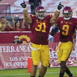 Soma Vainuku celebrates his 11-yard touchdown run.