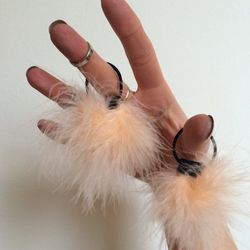 Deck out your raver buns or pigtails with these fuzzy hairties (because Baby would want you to).