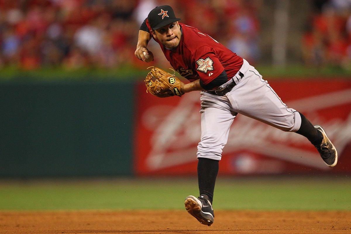 ST. LOUIS, MO - JULY 26: Jose Altuve #27 of the Houston Astros throws to first base against the St. Louis Cardinals at Busch Stadium on July 26, 2011 in St. Louis, Missouri.  The Cardinals beat the Astros 3-1.  (Photo by Dilip Vishwanat/Getty Images)
