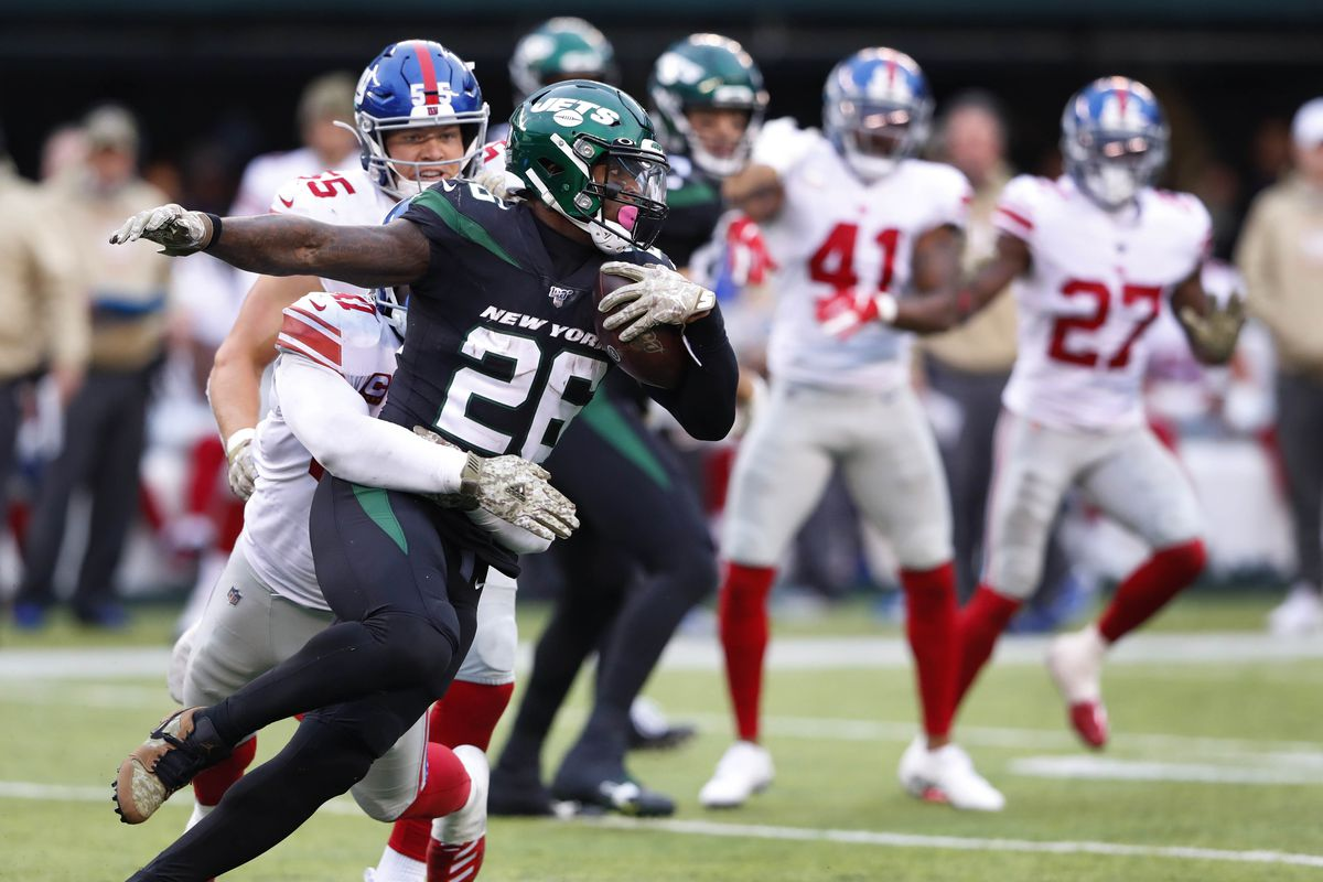 New York Jets running back Le'Veon Bell is tackled by New York Giants free safety Antoine Bethea during the second half at MetLife Stadium.