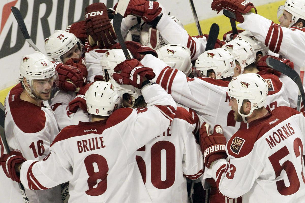 Phoenix Coyotes goalie Mike Smith (41) celebrates with teammates after the Coyotes defeated the Chicago Blackhawks 4-0 in Game 6 of an NHL hockey Stanley Cup first-round playoff series in Chicago, Monday, April 23, 2012.