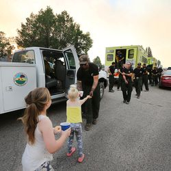 The Ruby Mountain Hotshots are met by kids, doughnuts and lemonade as crews return from fighting the Brian Head Fire near the town of Panguitch on Tuesday, June 27, 2017.