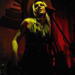 Caitlin Crosby performing