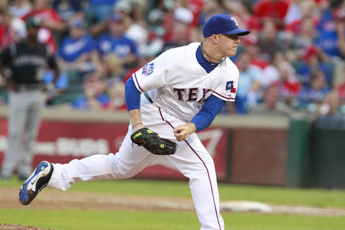 Jun 24, 2012; Arlington, TX, USA; Texas Rangers pitcher Robbie Ross (46) throws a pitch during the sixth inning of the game against the Colorado Rockies at Rangers Ballpark. The Rangers beat the Rockies 4-2. Mandatory Credit: Tim Heitman-US PRESSWIRE