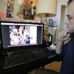 Austin Cloes, a relative of the Americans killed in Mexico, looks at a photo of the children who survived the attack in a hospital during an interview on Tuesday, Nov. 5, 2019, in Herriman. Drug cartel gunmen ambushed three SUVs along a dirt road, slaughtering at least six children and three women, all of them U.S. citizens living in northern Mexico, in a grisly attack that left one vehicle a burned-out, bullet-riddled hulk, authorities said.