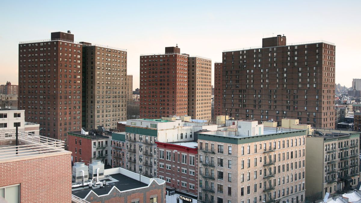 Public housing projects rise into a blue sky.