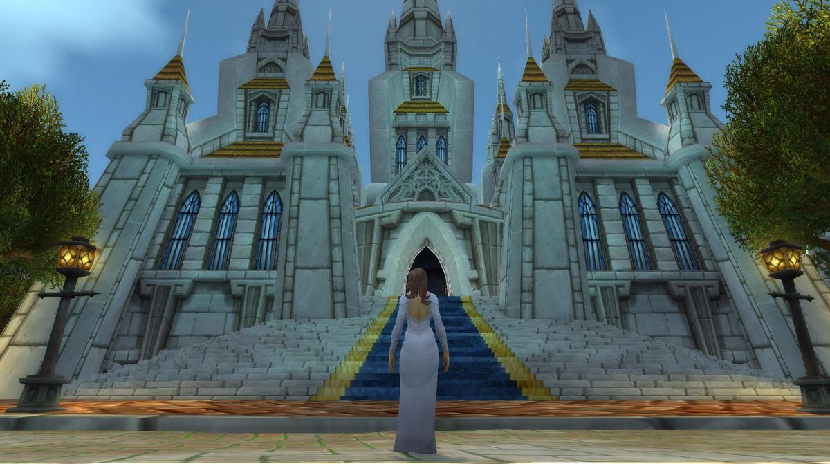 World of Warcraft - a character in a wedding dress stands before Stormwind Cathedral