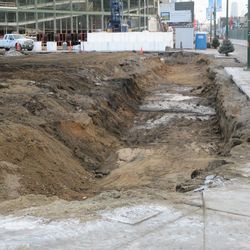 """A """"trench"""" has been dug in the northwest corner of the triangle lot. This is the view from Clark"""