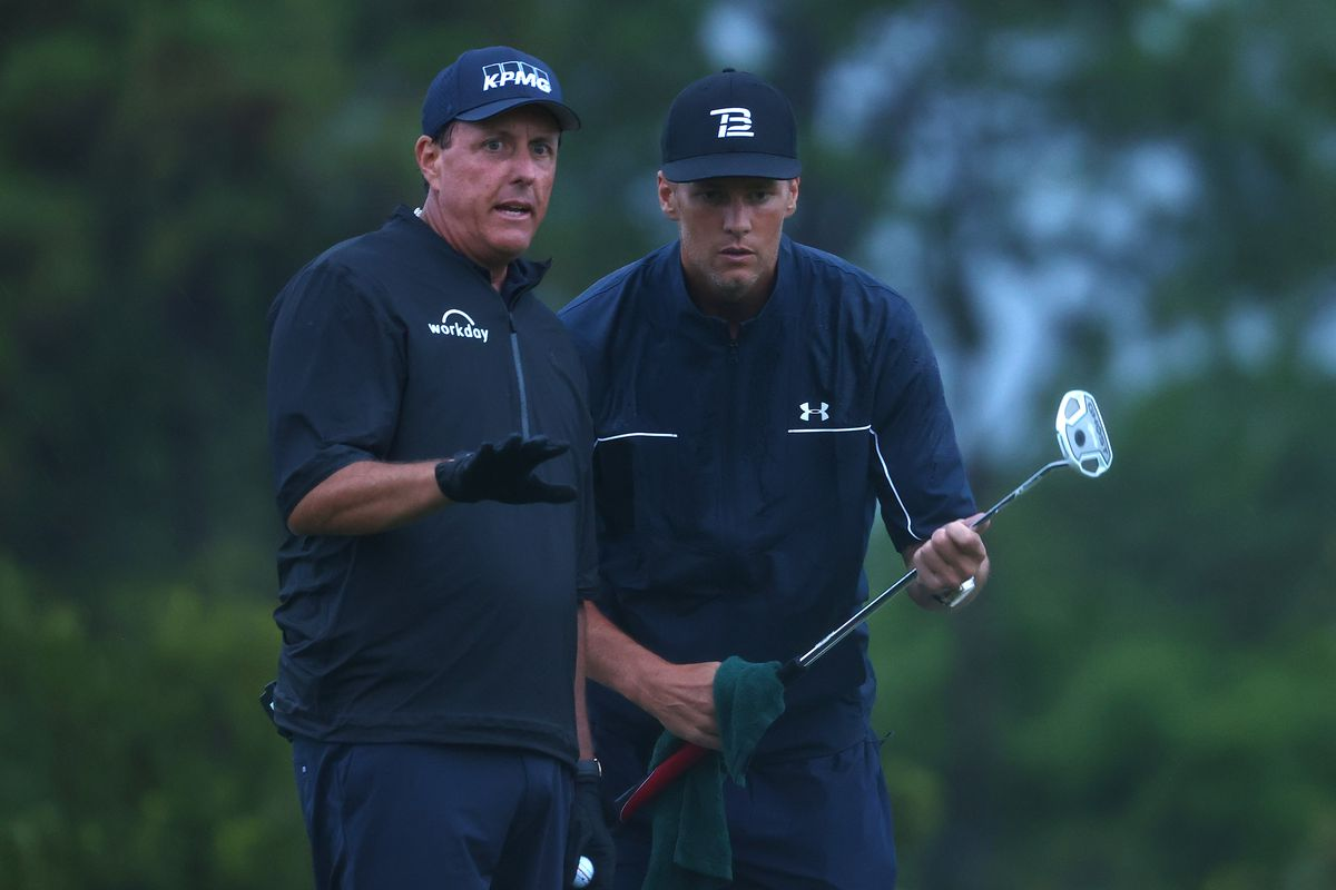 Phil Mickelson reads a putt for NFL player Tom Brady of the Tampa Bay Buccaneers on the 17th green during The Match: Champions For Charity at Medalist Golf Club on May 24, 2020 in Hobe Sound, Florida.