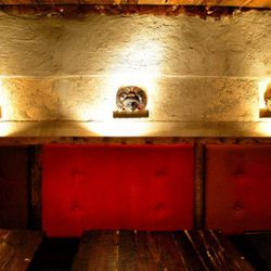 El Centro DF's walls are intentionally unfinished and the cave-like tequileria is decorated with hand-cut masks.