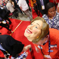 A delegate wears a Hillary Clinton mask during the final night of the National Republican Convention in Cleveland on Thursday, July 21, 2016.