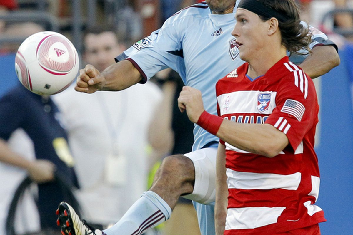 FRISCO, TX - OCTOBER 9:  Pablo Mastroeni #25 of the Colorado Rapids battles Zach Loyd #19 of FC Dallas at Pizza Hut Park on October 9, 2010 in Frisco, Texas.  (Photo by Brandon Wade/Getty Images)