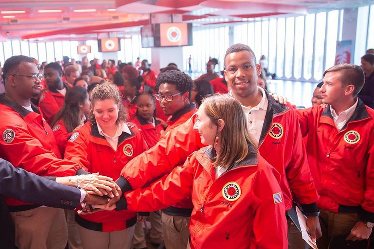 City Year Americorp members close their  graduation ceremony with a spirited celebration.