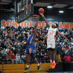 Simeon's Kejuan Clements (0) gets his shot blocked by Young's DJ Steward (21), Wednesday 02-13-19. Worsom Robinson/For the Sun-Times.