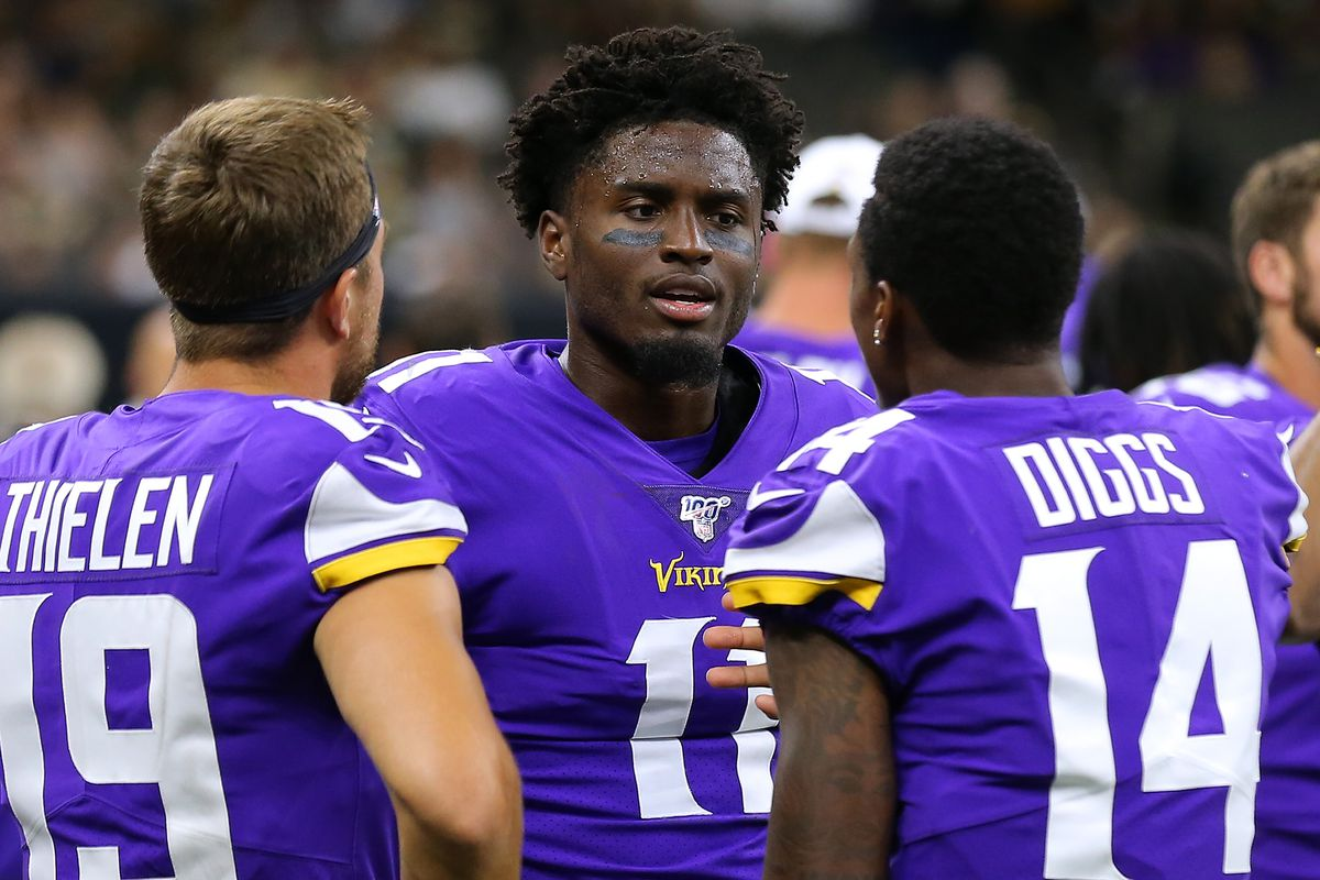 Minnesota Vikings wide receiver Laquon Treadwell talks to fellow receivers Stefon Diggs and Adam Thielen during a preseason game at the Mercedes Benz Superdome on August 09, 2019 in New Orleans, Louisiana.