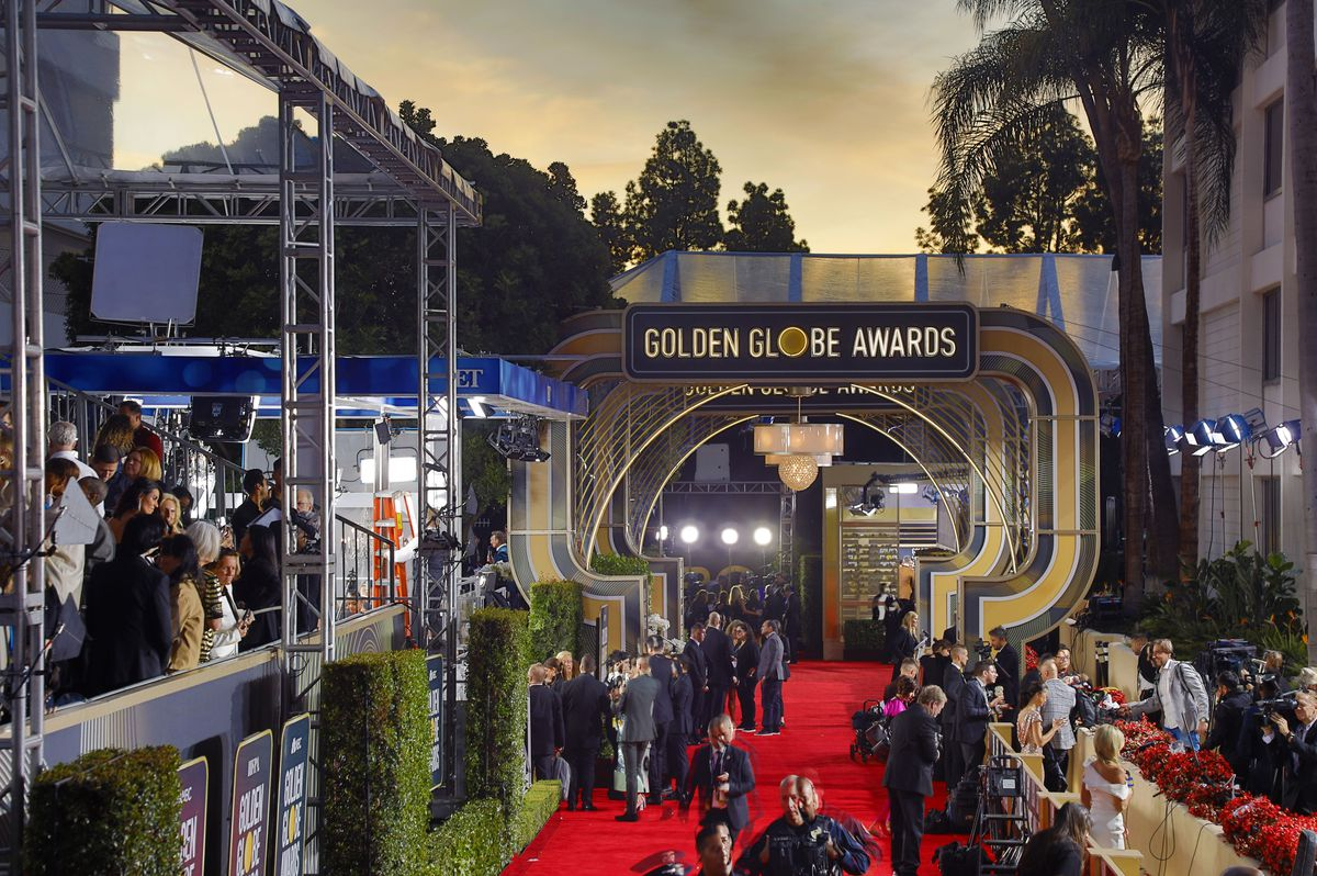 A big red carpet covered in press and celebrities.