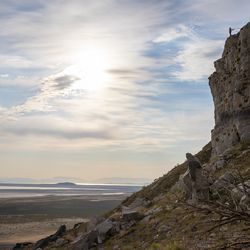 Hawkwatch International research associate Dustin Maloney rigs a rappel at a golden eagle nest site in Tooele County on Friday, June 18, 2021.