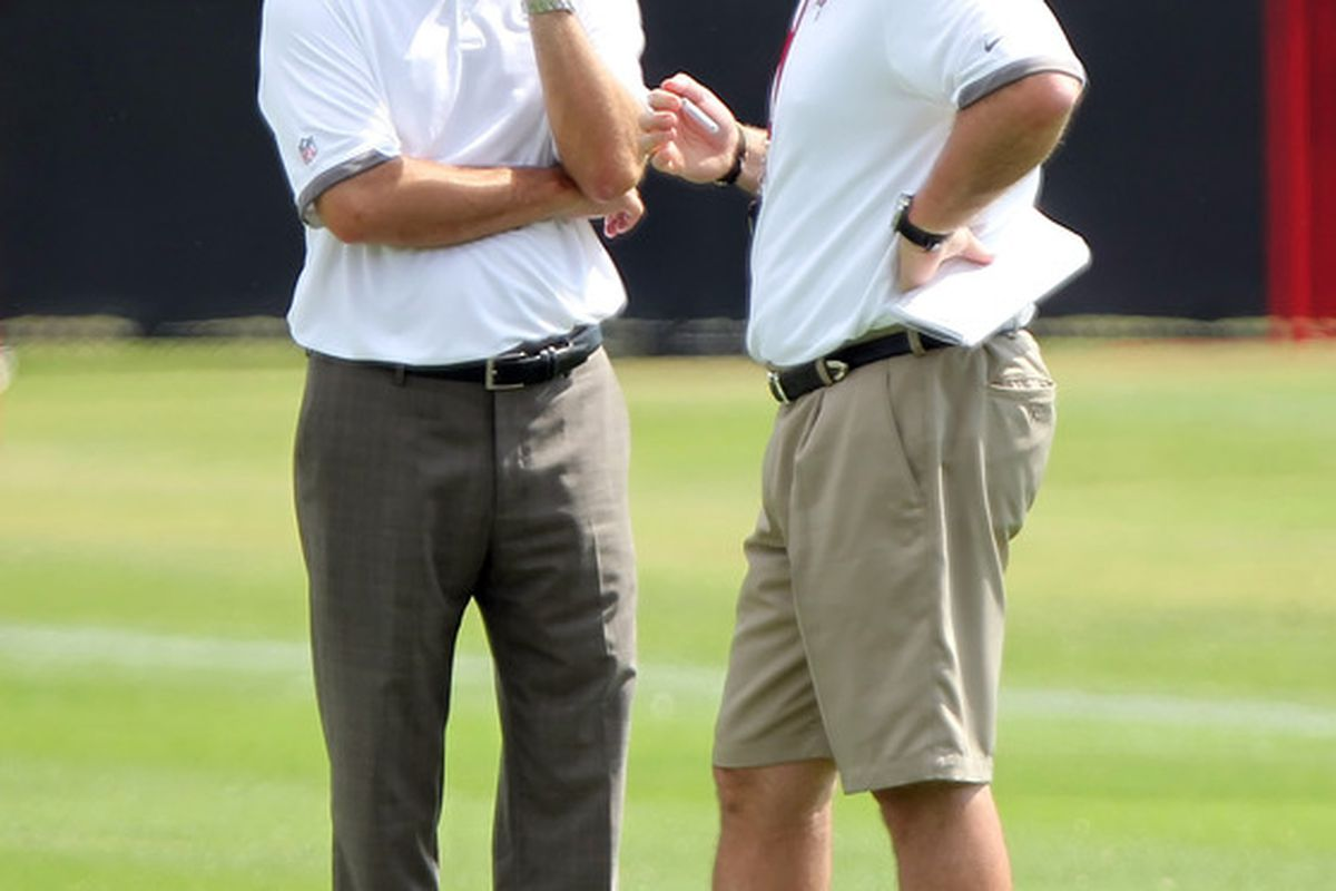 May 4, 2012; Tampa, FL, USA;  Tampa Bay Buccaneers general manager Mark Dominik and head coach Greg Schiano talk during rookie mini camp at One Buc.   Mandatory Credit: Kim Klement-US PRESSWIRE