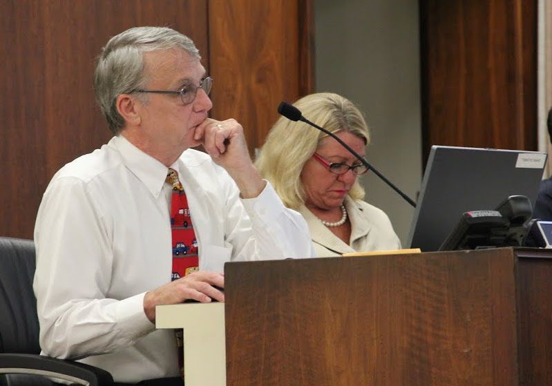 Shelby County school board member Chris Caldwell listens during aboard meeting.