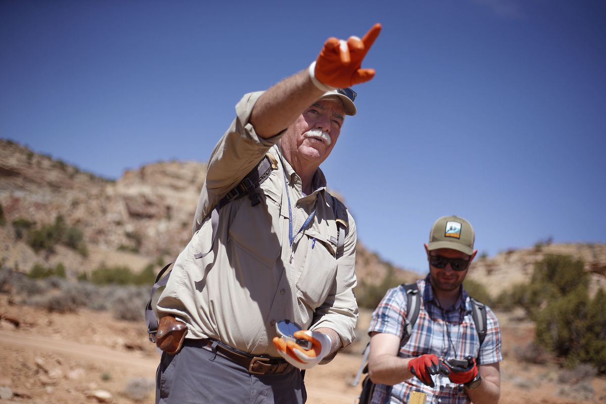 Dan Proctor and his son, Nick, use a compass and GPS to locate their claim posts in the Colt Mesa area of the former Grand Staircase-Escalante National Monument on Friday, May 14, 2021. The Proctors are required to maintain the active status of their claims and fill out notice of location forms at their claim posts.
