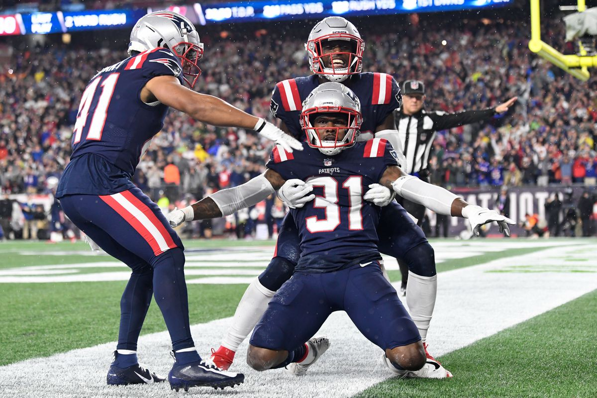 New England Patriots free safety Devin McCourty (32) celebrates with defensive back Jonathan Jones (31) and cornerback Myles Bryant (41) after breaking up a pass in the end zone during the second half of a game against the Tampa Bay Buccaneers at Gillette Stadium.
